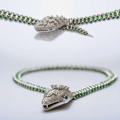 Flexible white gold necklace an bracelet representing a snake set with emerald cabochon and diamonds?
