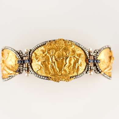 Gold figural panel bracelet with diamonds, sapphires and pearls