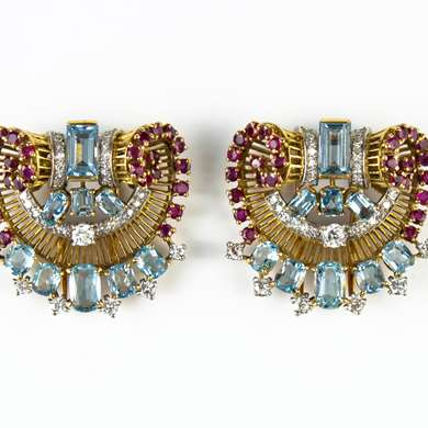 Pair of gold, blue topaze, ruby and diamonds clip brooch by Boucheron