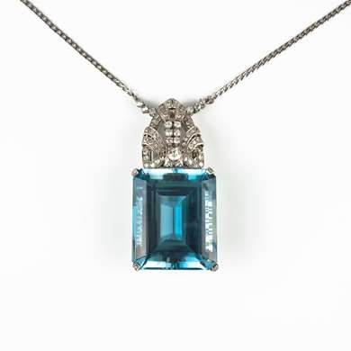 Platinum blue topaz and diamonds pendant