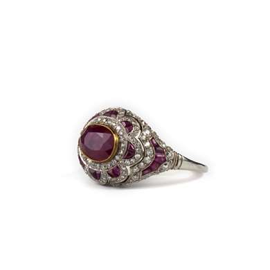 Platinum and gold ruby and diamond ring