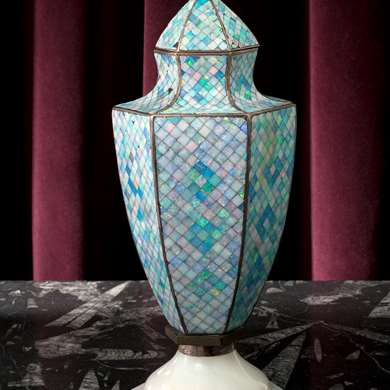 A silver urn decorated with opals forming a mosaic