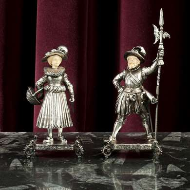 A pair of silver figures of a gardener and a medieval guard