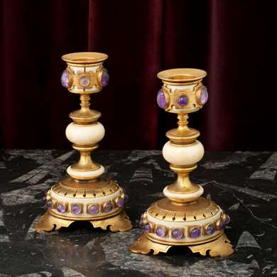 A pair of gilt-bronze and ivory candlesticks