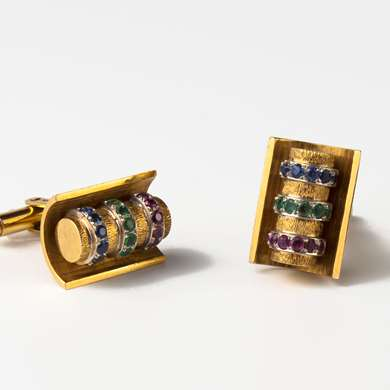 Cufflinks in yellow gold set with a row of rubies, sapphires and emeralds.