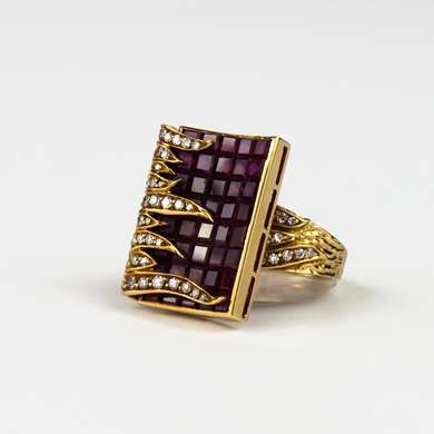 Gold ring set with a ruby calibrated paving and gold flames set with old size brilliant.