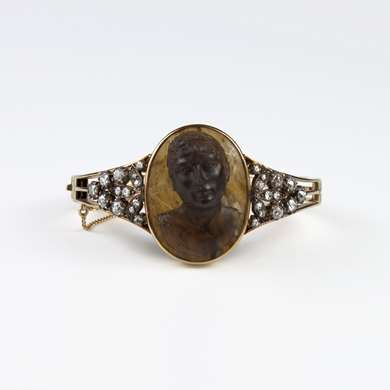 Rigid hinged yellow gold bracelet set with a cameo agate center in high relief depicting a Greek philosopher.
